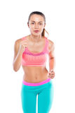 Full length portrait of young fitness girl running isolated Stock Photos