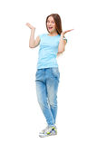 Full length portrait of young girl in casual clothing isolated Royalty Free Stock Photos