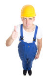 Full length portrait of young handsome man builder in blue unifo Royalty Free Stock Photography