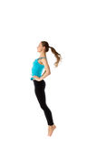 Full length portrait of a young jumping girl in sportswear Royalty Free Stock Images