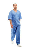 Full length portrait of a young male doctor in a medical surgica Stock Images