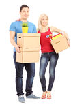 Full length portrait of a young male and female holding moving b Stock Photos