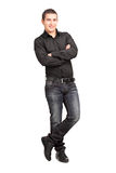Full length portrait of a young male leaning against wall. On white background Stock Images