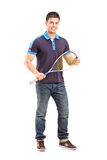 Full length portrait of a young male racquetball player. Isolated on white background Royalty Free Stock Photo