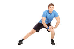 Full length portrait of a young maleathlete exercising Royalty Free Stock Photography