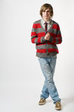 Full length portrait of young man. On light grey background royalty free stock images