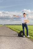 Full length portrait of young man with anywhere sign gesturing on countryside Royalty Free Stock Photos