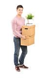 Full length portrait of a young man carrying removal boxes Royalty Free Stock Photography
