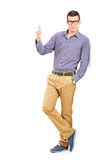 Full length portrait of a young man giving a thumb up Stock Photo