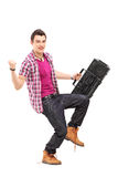 Full length portrait of a young man holding a radio and gesturin Royalty Free Stock Images