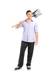 Full length portrait of a young man holding a shovel Stock Photos