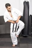 Full length portrait of young man in kimono trainig karate Royalty Free Stock Photos