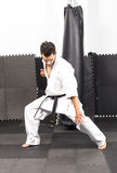 Full length portrait of young man in kimono trainig karate Royalty Free Stock Images