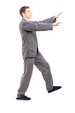 Full length portrait of a young man in pajamas sleepwalking. On white background Royalty Free Stock Images