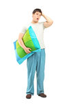 Full length portrait of a young man in pijamas feeling sleepy Royalty Free Stock Image
