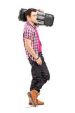 Full length portrait of a young  man posing with a radio on his Royalty Free Stock Images