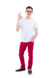 Full length portrait of young man showing ok sign isolated on wh Royalty Free Stock Photos