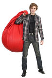 Caucasian young man with bean bag. Full length portrait of young man standing with big bean bag on white background stock images