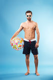 Full length portrait of a young man in summer wear Stock Photography