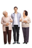 Full length portrait of young man with two mature women Stock Photography