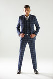 Full length portrait of young man wearing checked suit Stock Photos