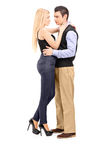 Full length portrait of a young man and woman hugging Stock Images