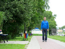 Full-length portrait of a young middle-aged man in a blue jacket Royalty Free Stock Image