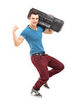 Full length portrait of a young muscular man posing with a radio Royalty Free Stock Photo