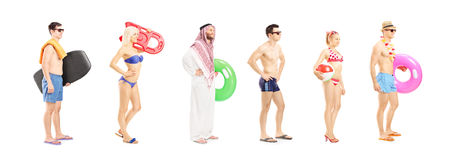 Full length portrait of young people with summer objects waiting Royalty Free Stock Images