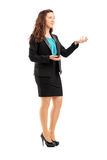 Full length portrait of a young professional woman during a disc Royalty Free Stock Image