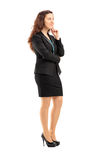 Full length portrait of a young professional woman thinking Stock Photography