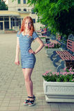 Full length portrait of a young sensual redhead Royalty Free Stock Photos