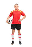 Full length portrait of a young soccer player holding a ball Royalty Free Stock Photography