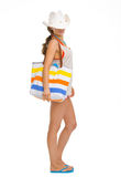 Full length portrait of young woman with beach bag Royalty Free Stock Image