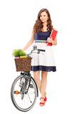 Full length portrait of a young woman with a bicycle Royalty Free Stock Images