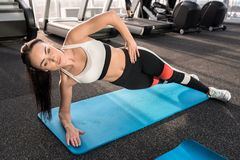 Young Woman Working Out in Gym royalty free stock photos