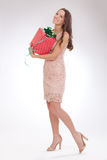 Full length portrait of a young woman happy dear gift stock photography