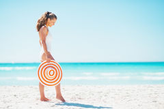 Full length portrait of young woman with hat on beach Royalty Free Stock Image