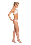 Full length portrait of young woman in lingerie going sideways Royalty Free Stock Photos