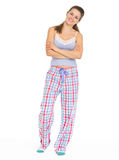 Full length portrait of young woman in pajamas. Isolated on white stock photo
