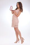 Full length portrait of a young woman in a pink dress Royalty Free Stock Photos