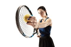 Full length portrait of young woman playing tennis isolated on white background stock photos
