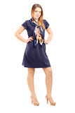 Full length portrait of a young woman posing in navy blue dress royalty free stock photos