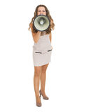 Full length portrait of young woman shouting through megaphone Royalty Free Stock Photography