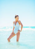 Full length portrait of young woman standing in sea Royalty Free Stock Images