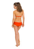 Full length portrait of young woman in swimsuit. rear view Stock Photo