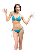 Full-length portrait of young woman wearing bikini. Full-length portrait of young woman wearing blue bikini, isolated on white. Concept of summer holidays and royalty free stock photo
