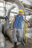 Full length portrait of young worker with wrench in industry Royalty Free Stock Photography