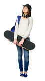 Full-length portrait of youngster with skateboard Royalty Free Stock Photography
