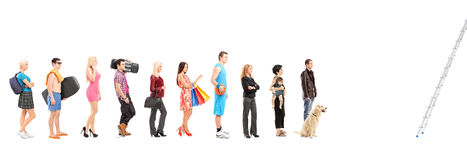 Full length portraits of people in a queue waiting to climb a la. Dder, isolated on white background royalty free stock image